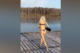 [VIDEO] Mujer salto a un lago congelado y esto fue lo que paso